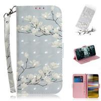 Decor PU kožené peněženkové puzdro na Sony Xperia 10 Plus - biela kvetina